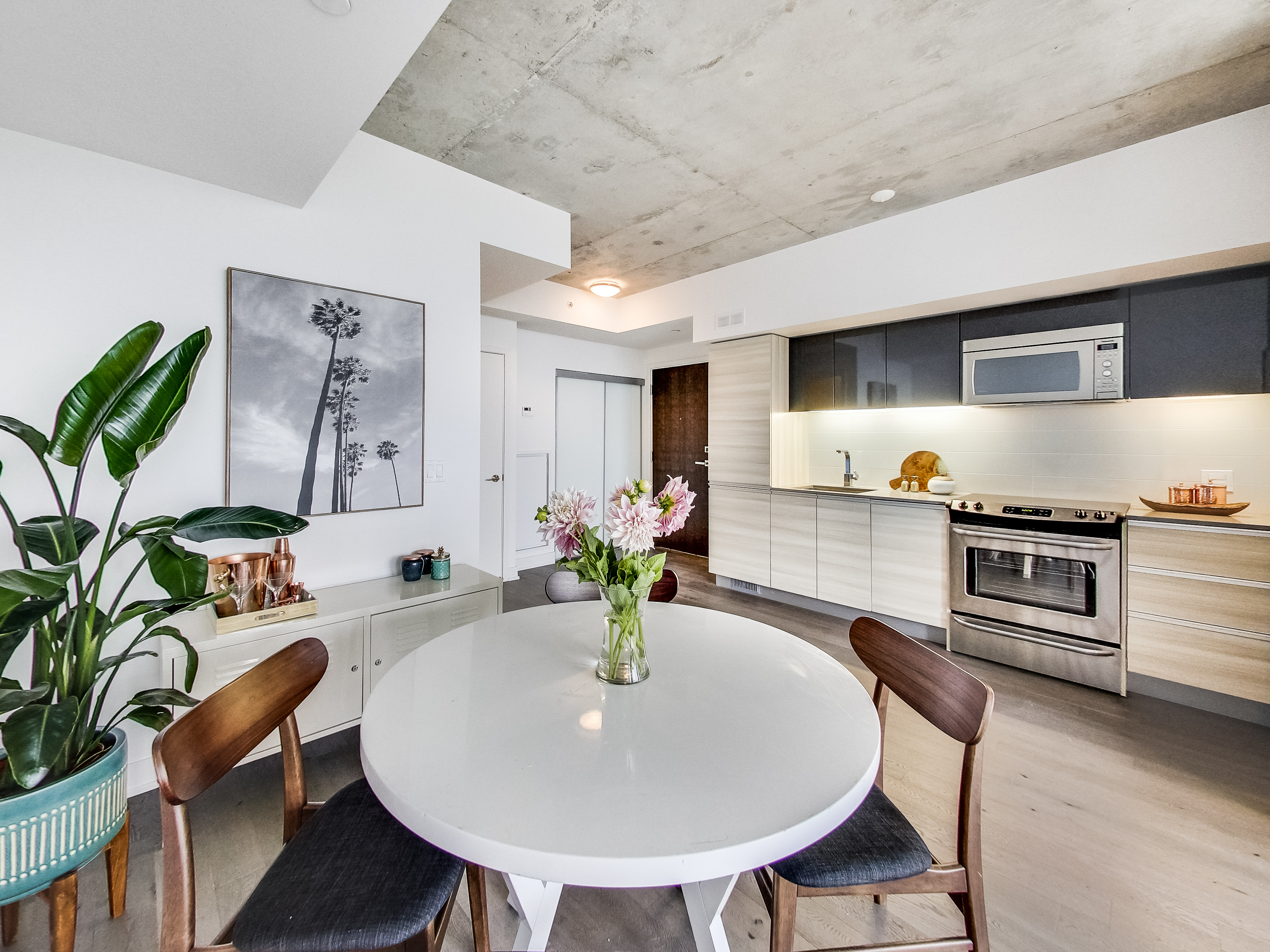 round dining table on wooden flooring open kitchen