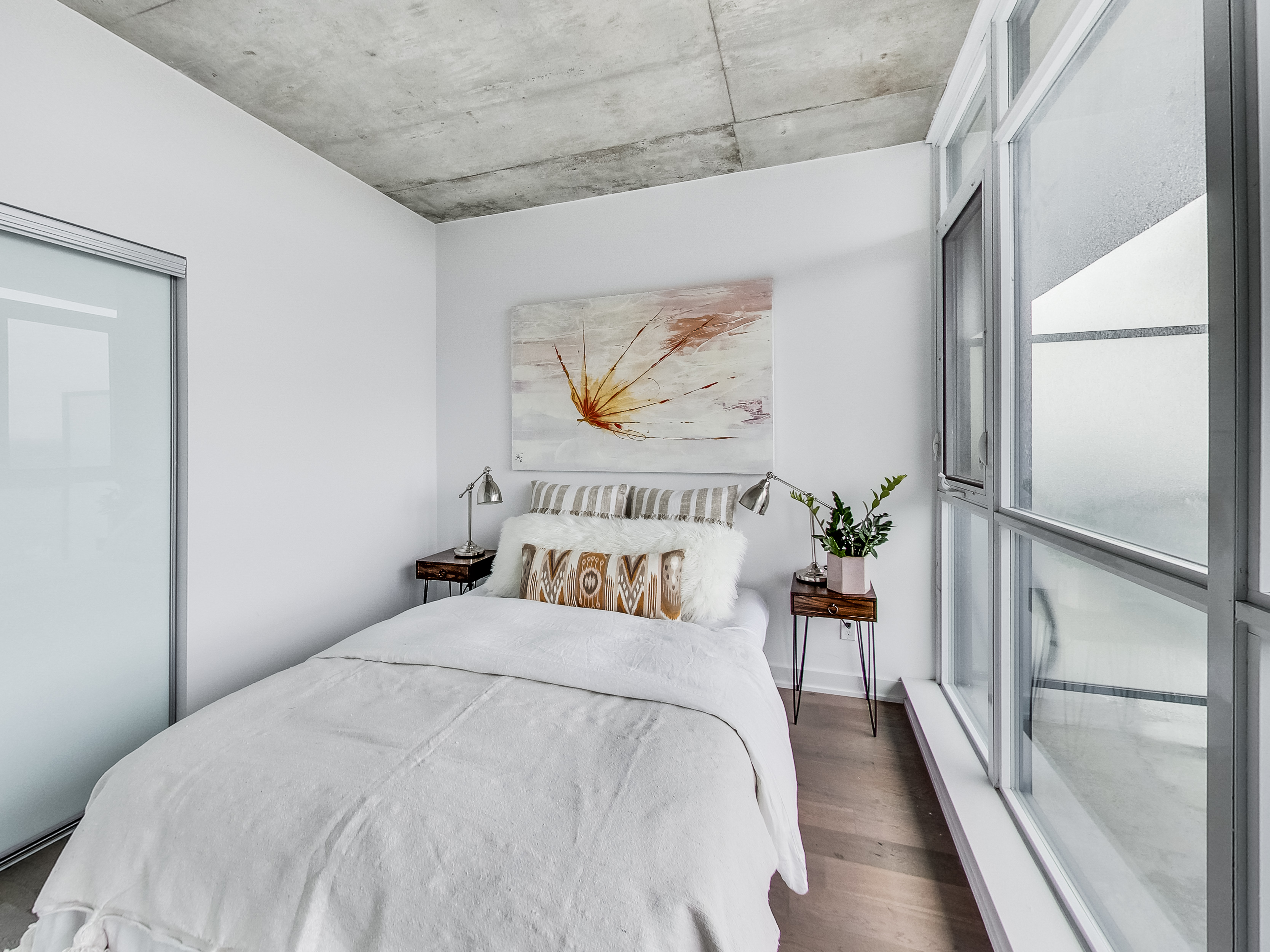 stunning white bedroom with window wall