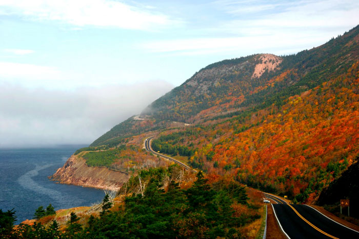 The Cabot Trail in the Fall with orange leaves