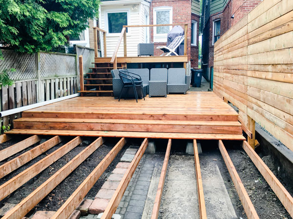 backyard fence and deck being built